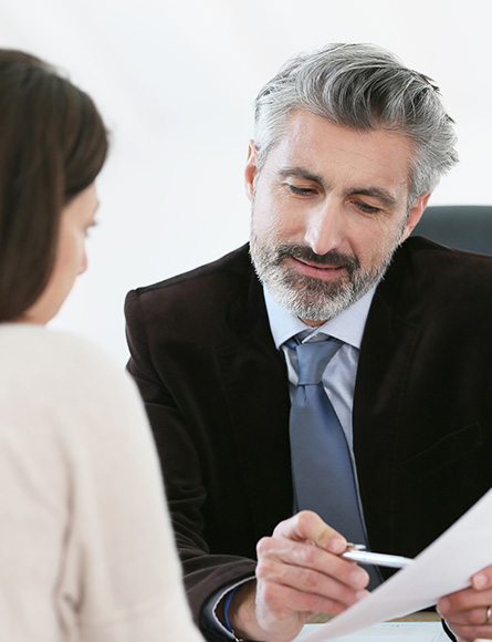 Lawyer Reviewing Paperwork With a Client